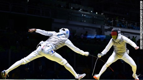 Germany's Peter Joppich (R) competes against France's Enzo Lefort during their mens individual foil qualifying bout as part of the fencing event of the Rio 2016 Olympic Games, on August 7, 2016, at the Carioca Arena 3, in Rio de Janeiro. / AFP / Fabrice COFFRINI        (Photo credit should read FABRICE COFFRINI/AFP/Getty Images)
