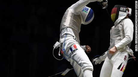 Germany's Peter Joppich (R) competes against France's Enzo Lefort during their mens individual foil qualifying bout as part of the fencing event of the Rio 2016 Olympic Games, on August 7, 2016, at the Carioca Arena 3, in Rio de Janeiro. / AFP / Kirill KUDRYAVTSEV        (Photo credit should read KIRILL KUDRYAVTSEV/AFP/Getty Images)