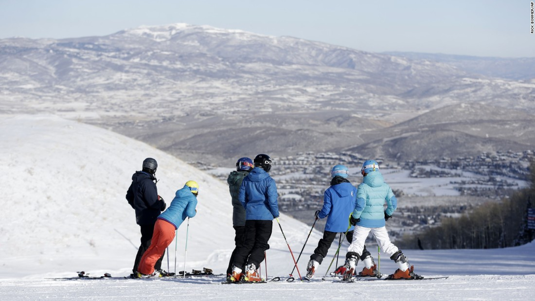 Winter or summer, Park City is the center of a booming tourism industry. In the warmer months, there's hiking and biking, and when snow falls, skiers like this group head to Park City Mountain Resort. <br />