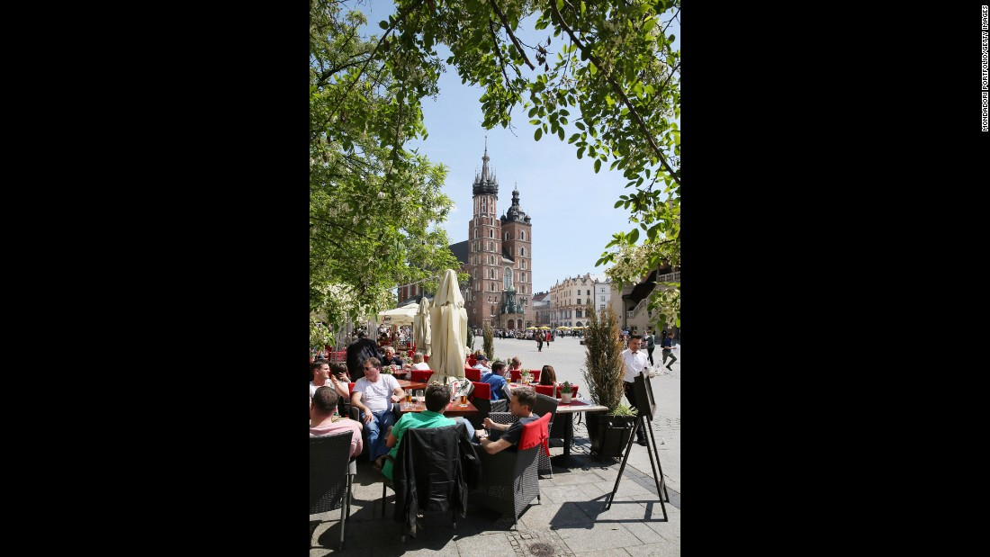 Tourists sit in Rynek Glowny, Krakow's main square. The city is one of Poland's oldest and is home to some magnificent medieval architecture.