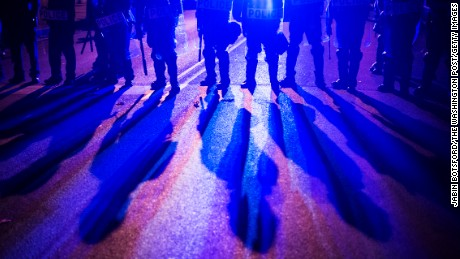 File Photo : Officers stand guard just after the 10 p.m. curfew at the intersection of West North Avenue and Pennsylvania Avenue as protestors walk for Freddie Gray around the city after it was announced that criminal charges would be brought against all 6 officers involved in the Freddie Gray case as protestors have been walking for Freddie Gray around the city in Baltimore, MD on Friday May 01, 2015. Gray died from spinal injuries about a week after he was arrested and transported in a police van. Marilyn Mosby announced criminal charges against all six officers suspended after Freddie Gray suffered a fatal spinal injury while in police custody.