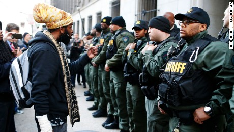 A protester yells at members of the Baltimore City Sheriffs Department after a mistrial was declared  in December 2015 in the trial of a Baltimore police officer charged in the death of Freddie Gray.