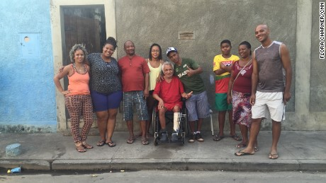 Silva's family outside their home.