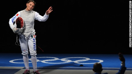 Italy's Margherita Granbassi waves at the referee after defeating fellow countrywoman Giovanna Trillini (unseen) in the Women's individual Foil Bronze medal match on August 11, 2008 at the Fencing Hall of National Convention center, as part of the 2008 Beijing Olympic games. Granbassi won 15-12.     AFP PHOTO / PHILIPPE DESMAZES (Photo credit should read PHILIPPE DESMAZES/AFP/Getty Images)