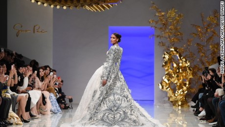 A model presents a creation by Guo Pei during the 2016 spring/summer Haute Couture collection on January 27, 2016 in Paris.    / AFP / MIGUEL MEDINA        (Photo credit should read MIGUEL MEDINA/AFP/Getty Images)