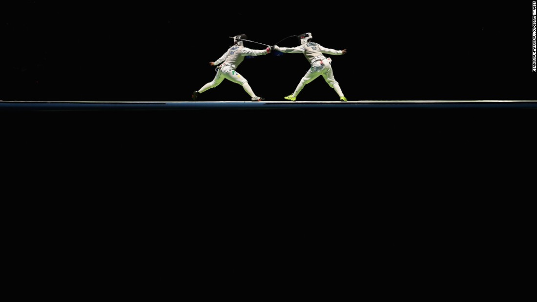 Brazilian fencer Tais Rochel, left, faces off against Saudi Arabia's Lubna Al-Omair during the women's individual foil competition.