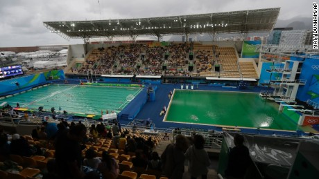 The water of the diving pool at right appears a murky green as the water polo pool at left appears a greener colour than the previous day.