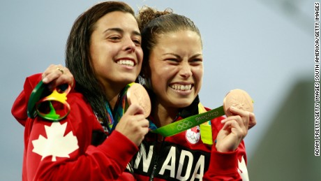 Canadian synchonized divers Meaghan Benfeito and Roseline Filion display their bronze medals.