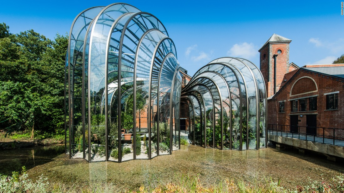 "Opened to the public in late 2014, the new Bombay Sapphire Distillery by <a href=""http://www.heatherwick.com/distillery/"" target=""_blank"">Heatherwick Studio</a> straddles the River Test in the village of Laverstoke, England. Two intertwining botanical glasshouses are a highlight of the central courtyard -- one tropical and the other Mediterranean -- housing and cultivating the 10 plant species that give Bombay Sapphire gin its particularity."