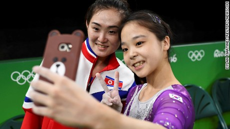 Gymnasts Lee Eun-Ju, of South Korea, left, takes a selfie picture with Hong Un Jong of North Korea on August 4 in Rio de Janeiro, Brazil.