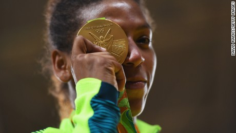 Rafaela Silva of Brazil celebrates after winning the gold medal in the Women's -57 kg Final - Gold Medal Contest on Day 3 of the Rio 2016 Olympic Games at Carioca Arena 2 on August 8, 2016 in Rio de Janeiro, Brazil.