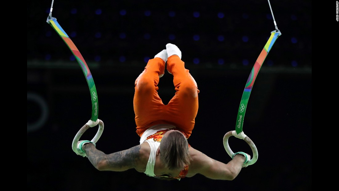 Azerbaijan's Oleg Stepko performs on the rings during the men's individual all-around.