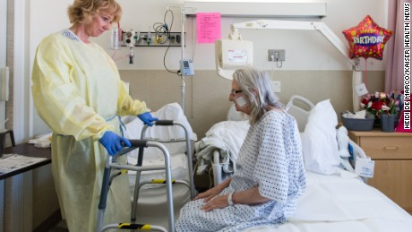 Nurse specialist Annelie Nilsson checks on patient Janet Prochazka, 75, during her stay at Zuckerberg San Francisco General Hospital and Trauma Center on Thursday, March 24, 2016. (Heidi de Marco/KHN)