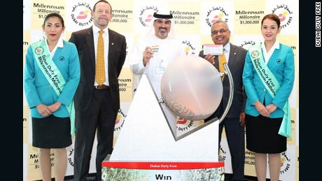 Khadar, second from right, accepts his prize