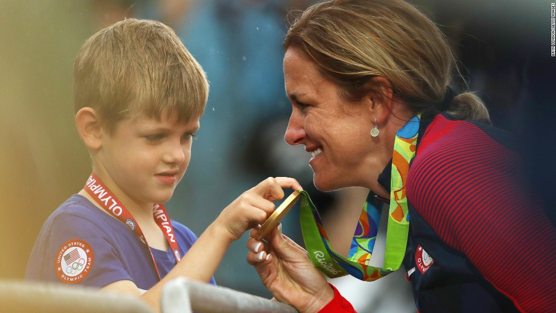 "American cyclist Kristin Armstrong shows her gold medal to her son, Lucas, after <a href=""http://edition.cnn.com/2016/08/10/sport/kristin-armstrong-cycling-usa/index.html"" target=""_blank"">winning the time trial</a> for the third straight Olympics. Williams won the event a day before turning 43 years old. She was the oldest woman in the field by seven years."