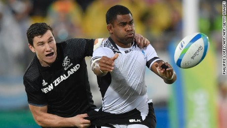 New Zealand's Sam Dickson (L) tackles Fiji's Vatemo Ravouvou in the mens rugby sevens quarter-final match between Fiji and New Zealand during the Rio 2016 Olympic Games at Deodoro Stadium in Rio de Janeiro on August 10, 2016. / AFP / PHILIPPE LOPEZ        (Photo credit should read PHILIPPE LOPEZ/AFP/Getty Images)