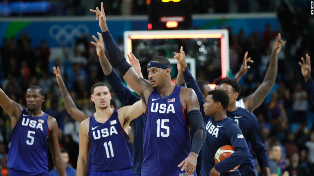 The U.S. basketball team walks off the court after its 98-88 victory over Australia. The Aussies gave the heavily favored Americans a scare, leading by five points at halftime.