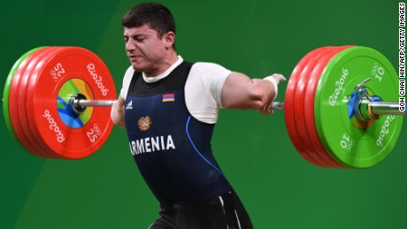 Armenia's Andranik Karapetyan sustains an injury while competing during the Men's 77kg weightlifting competition at the Rio 2016 Olympic Games in Rio de Janeiro on August 10, 2016.  / AFP / GOH Chai Hin        (Photo credit should read GOH CHAI HIN/AFP/Getty Images)