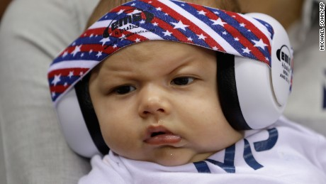 Michael Phelps' son Boomer wears ear protection during the swimming events at the Rio Olympics.