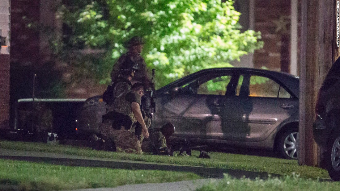 Police keep watch during the standoff Wednesday night.