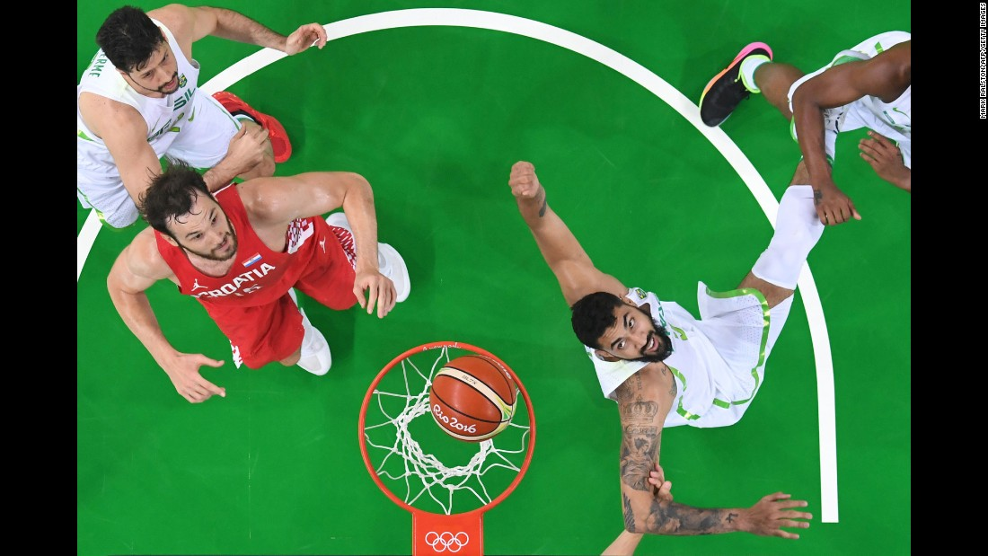 Croatian center Miro Bilan, second left, eyes a rebound during a game against Brazil.