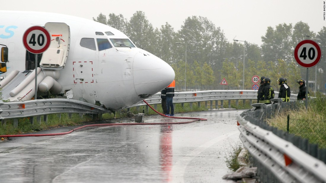 "Firefighters work near a cargo plane that <a href=""http://www.cnn.com/2016/08/05/europe/italy-plane-overshoots/"" target=""_blank"">skidded off a runway</a> and onto a provincial highway near Bergamo, Italy, on Friday, August 5. No one was hurt."