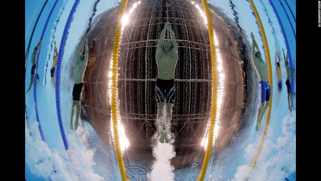 "American Nathan Adrian swims the 100-meter freestyle on Tuesday, August 9. ""It's a very time-consuming, tedious operation to get things correct,"" Bello said of underwater photography. ""There's a lot of setup way, way, way ahead of time."""