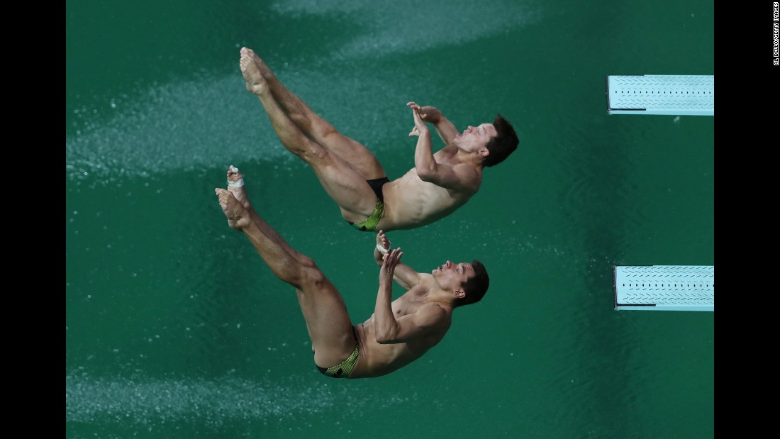 German divers Stephan Feck and Patrick Hausding compete in the 3-meter springboard final on Wednesday, August 10.