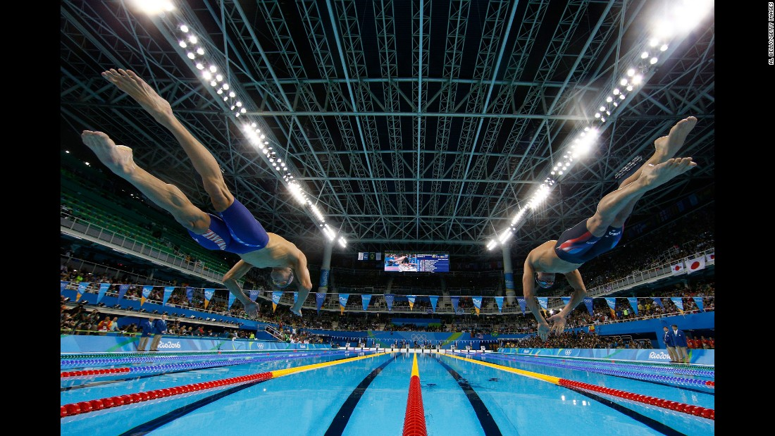 Phelps, left, and U.S. teammate Ryan Lochte jump into the pool for the 200-meter medley on Wednesday, August 10.