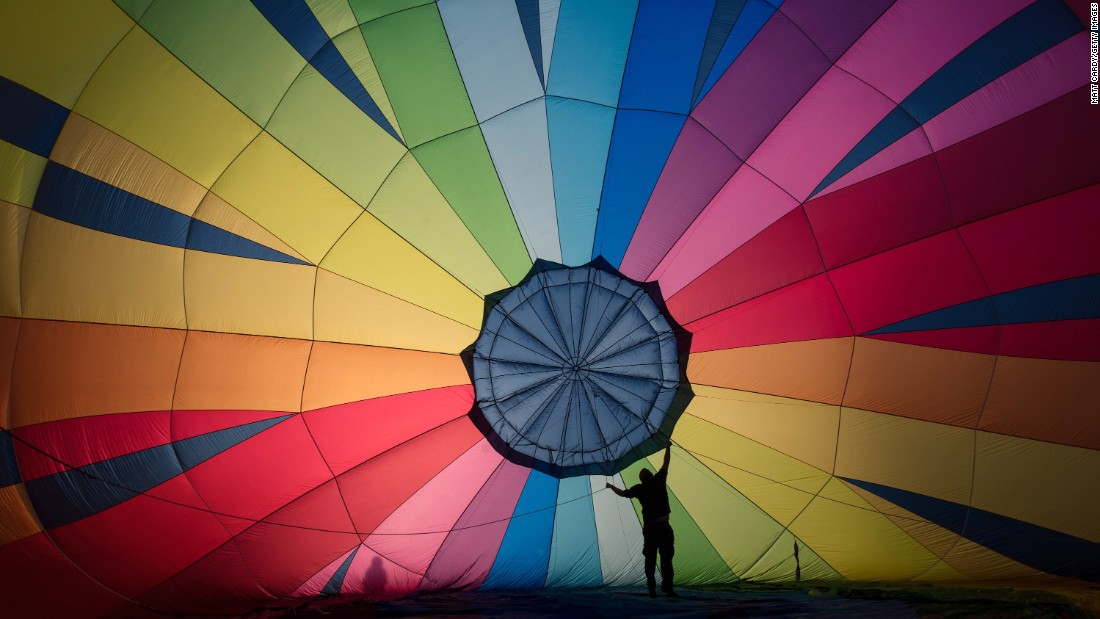 A hot-air balloon is prepared Friday, August 5, ahead of a four-day balloon festival in Bristol, England. The city is seen by many as the home of modern ballooning.