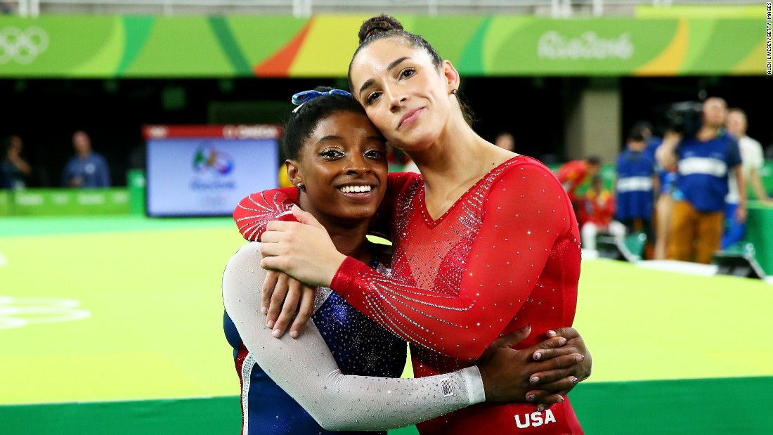 Biles hugs her teammate Aly Raisman, who won the silver.