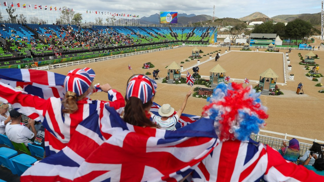 British fans cheer Charlotte Dujardin in the team dressage Grand Prix event.