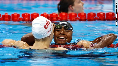 American Simone Manuel hugs Canada's Penny Oleksiak after their tie in the women's 100m freestyle.