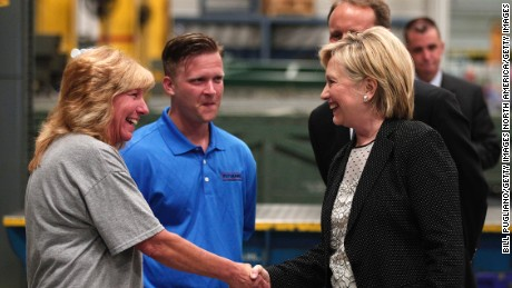 WARREN, MI - AUGUST 11: Democratic presidential nominee Hillary Clinton (right) tours Futuramic Tool & Engineering before giving a speech there on the U.S. economy August 11, 2016 in Warren, Michigan. In her speech, Clinton contrasted her economic plan to that of Republican presidential nominee Donald Trump's. (Photo by Bill Pugliano/Getty Images)
