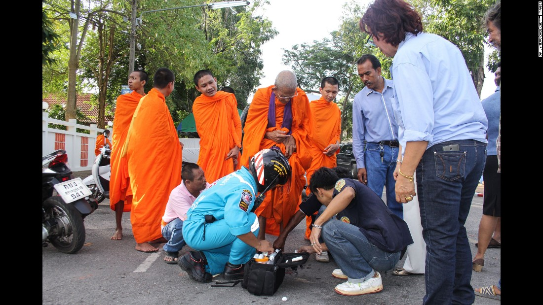 A Buddhist monk is treated for a foot wound at the scene of an explosion in the southern province of Surat Thani on August 12.