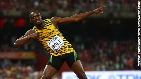 Usain Bolt of Jamaica celebrates after winning gold in the Men's 100 metres final during day two of the 15th IAAF World Athletics Championships Beijing 2015