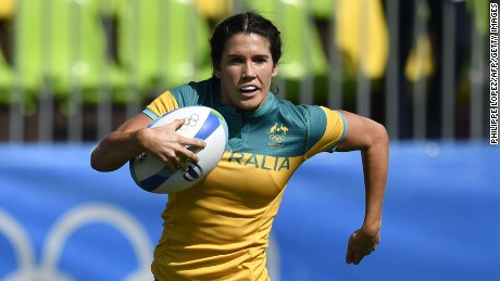 Australia's Charlotte Caslick scores a try in the womens rugby sevens match between Australia and Colombia during the Rio 2016 Olympic Games at Deodoro Stadium in Rio de Janeiro on August 6, 2016. / AFP / PHILIPPE LOPEZ        (Photo credit should read PHILIPPE LOPEZ/AFP/Getty Images)