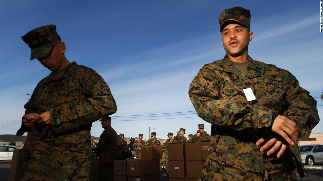 Marines try on the Marine Corps Combat Utility Uniform in 2002. The uniform has a digital-like pattern of squares designed for effective camouflaging, combat utility and durability.