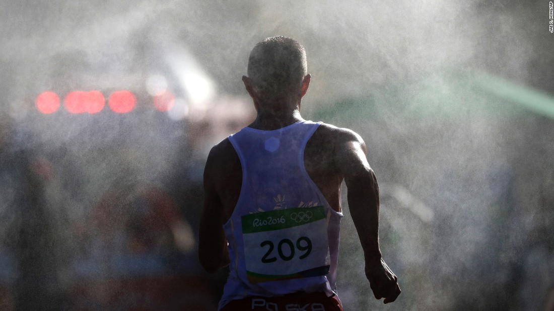Artur Brzozowski, a race walker from Poland, makes his way through the mist during the 20-kilometer event.
