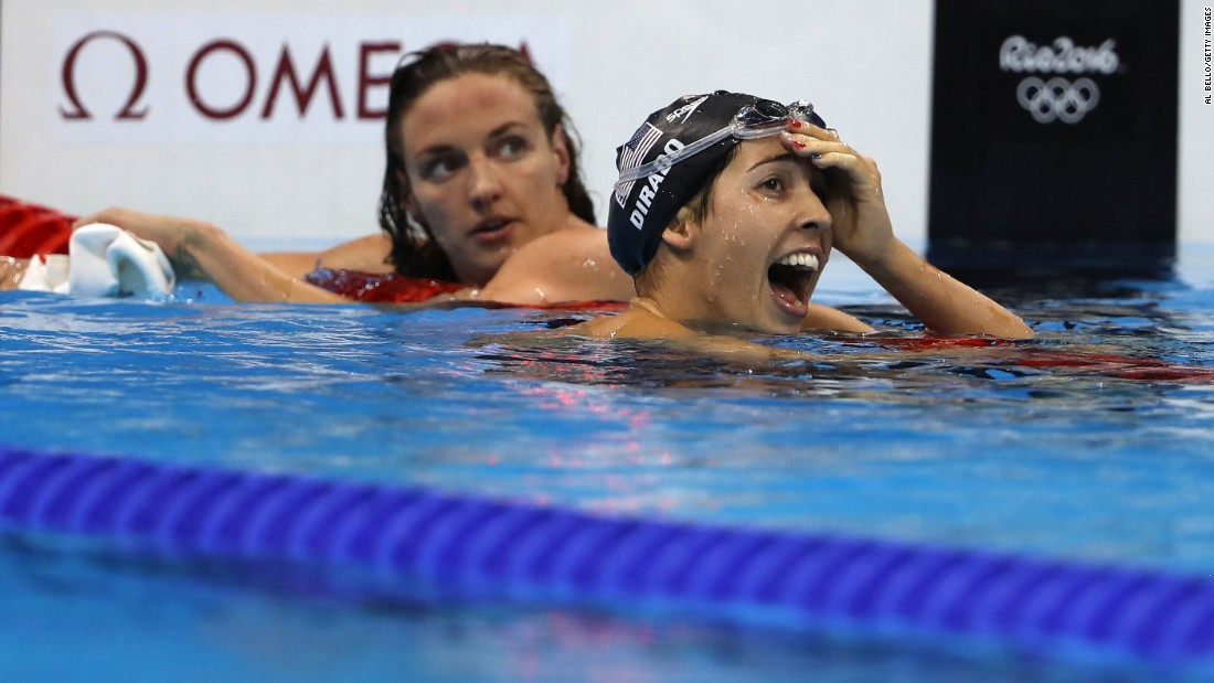 Maya DiRado, right, looks up at her time after winning the 200-meter backstroke. DiRado was trailing Hungary's Katinka Hosszu, left, for much of the race but edged her at the end. It is DiRado's second gold medal in Rio.