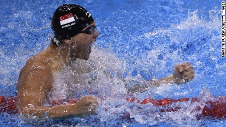 Singapore's Joseph Schooling celebrates after the Men's 100m Butterfly Final during the swimming event at the Rio 2016 Olympic Games at the Olympic Aquatics Stadium in Rio de Janeiro on August 12, 2016.   / AFP / Martin BUREAU        (Photo credit should read MARTIN BUREAU/AFP/Getty Images)