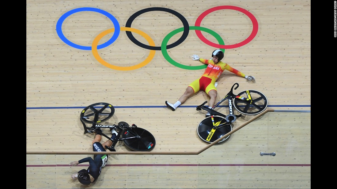 New Zealand's Olivia Podmore, left, and Spain's Tania Calvo Barbero fall during the keirin first round track cycling event.