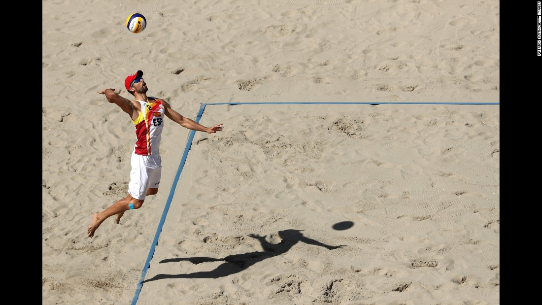 Adrian Gavira Collado of Spain serves the ball during a round of 16 beach volleyball match.