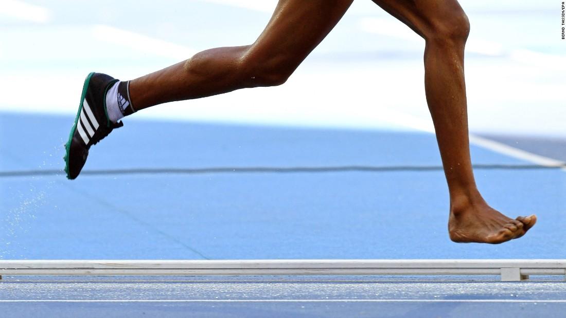 Etenesh Diro of Ethiopia loses her shoe during the women's 3,000-meter steeplechase heats.