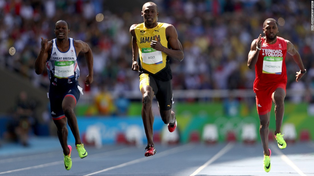 Usain Bolt, center, Richard Thompson of Trinidad and Tobago and James Dasaolu of Great Britain compete in the men's 100-meters.