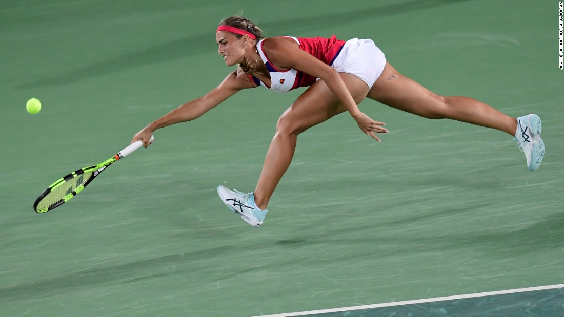 Puerto Rico's Monica Puig goes for the ball during her singles final tennis match against Germany's Angelique Kerber.