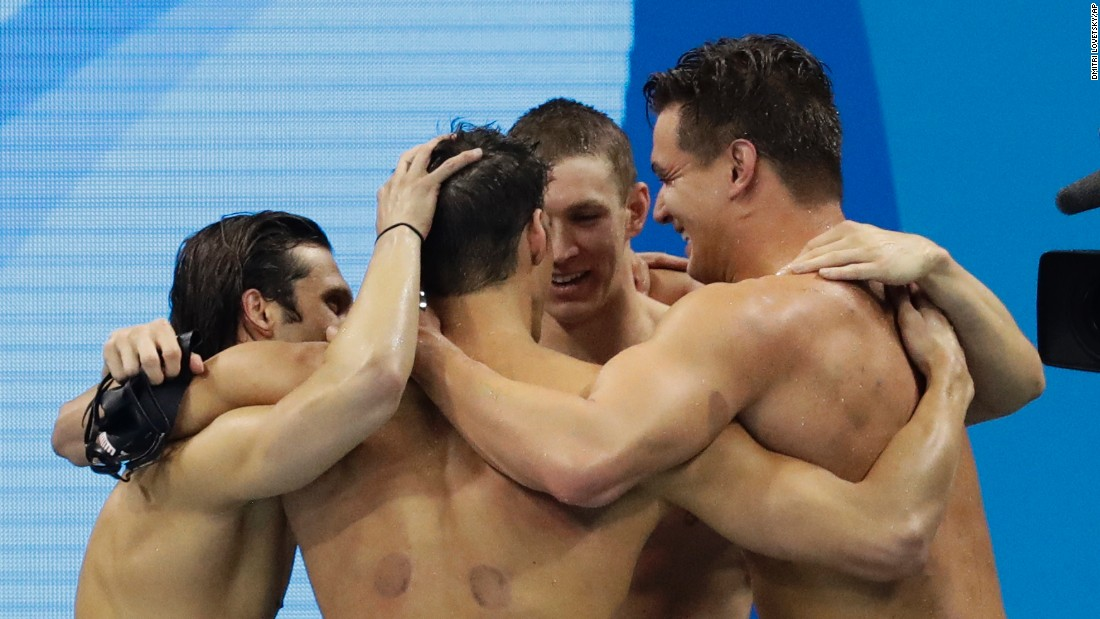 Swimmers Michael Phelps, Cody Miller, Ryan Murphy and Nathan Adrian of the United States embrace after winning the 4x100-meters medley. Murphy led the team early on with his world record backstroke leg, and the team ended up solidifying gold with an Olympic record finish.