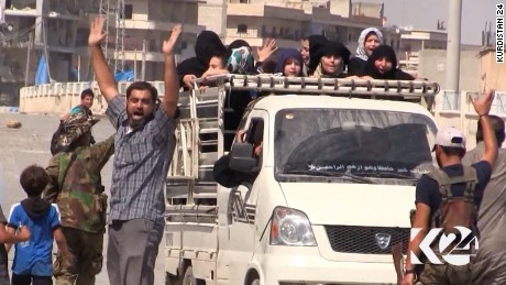Residents celebrate the Kurdish liberation of Manbij from ISIS.
