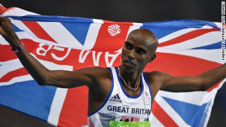 Britain's Mo Farah celebrates winning the Men's 10,000m during the athletics event at the Rio 2016 Olympic Games at the Olympic Stadium in Rio de Janeiro on August 13, 2016.   / AFP / Fabrice COFFRINI        (Photo credit should read FABRICE COFFRINI/AFP/Getty Images)