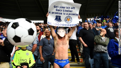 An Everton supporter holds a sign in May urging BBC presenter Gary Lineker to keep his promise.
